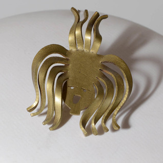 Catherine Butler Gold Face Pin